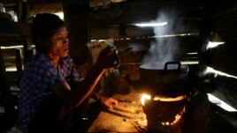(File Photo) A villager cooks dinner on a cook stove in Koh Kong province, west of Phnom Penh, Cambodia.