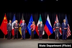 FILE - Secretary Kerry stands with fellow EU, P5+1 foreign ministers and Iranian Foreign Minister Zarif after reaching Iran nuclear deal, in Vienna, Austria, July 14, 2015.