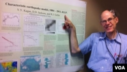 Tokyo University professor Robert Geller points to a poster of a soon-to-be-published document he co-authored asserting characteristic earthquake models developed in the past should be considered dead and buried. (Photo: VOA/Steve Herman)