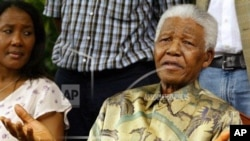File photo dated Thursday Jan. 6, 2005 of former South African President Nelson Mandela talking at a news conference, accompanied by his daughter Makaziwe, left, after his son Makgatho had died of AIDS. Mandela's daughter Makaziwe Mandela, spoke May 24, 2