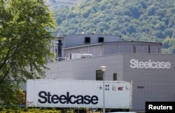 FILE - A trailer of office furniture maker Steelcase Inc. is seen in front of the company's plant in Wisches near Strasbourg, Eastern France, June 26, 2014.