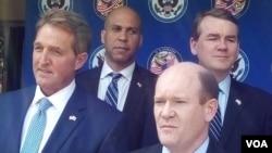 Senators Chris Coons, Jeff Flake and Cory Booker visiting Zimbabwe in 2017.