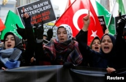 FILE - Demonstrators shout slogans during a protest against Iran's role in Aleppo, Syria, near the Iranian Consulate in Istanbul, Turkey, Dec. 16, 2016. The conflicts in Syria and Iraq have further chrystalized differences between Turkey and Iran both of which jockey for influence in the region.