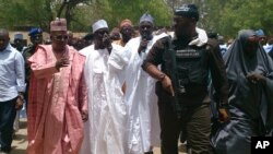 Borno State governor Kashim Shettima (left) visited the Chibok school where gunmen abducted more than 200 girls early last week.