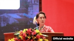 Aung San Suu Kyi at the Invest Myanmar Summit on Monday