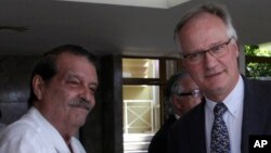 European Commission Director for the Americas and chief negotiator Christian Leffler, right, greets Cuba's Deputy Minister Abelardo Moreno before the start of their meeting in Havana, Cuba, March 4, 2015.