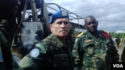 FILE - MONUSCO Force Commander General Carlos Alberto dos Santos Cruz, foreground, says there needs to be an evolution in the way MONUSCO works with the Congolese army. (Nick Long/VOA)