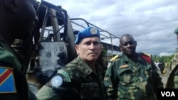 FILE - MONUSCO Force Commander General Carlos Alberto Dos Santos Cruz at the ambush site, Beni territory, eastern Congo, May, 2015. (Nicholas Long/VOA)