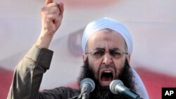 FILE - In this March 4, 2011, file photo, Sheikh Ahmed al-Assir, a Lebanese anti-Syrian regime leader, addresses his supporters during a demonstration against Syrian President Bashar Assad.