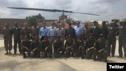 Members of a U.S. congressional delegation, headed by Republican Senator John McCain (6-L, 2nd row), pose for a picture with Dragon helicopter pilots from the Pakistani Air Force in Miramshah, North Waziristan, Pakistan, July 3, 2016. (@SenJohnMcCain)