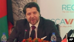 FILE - Deputy Foreign Minister Hekmat Khalil Karzai talks during the opening ceremony of the 6th Regional Economic Cooperation Conference of Afghanistan at the Foreign Affairs Ministry in Kabul, Sept. 3, 2015. Karzai revealed more than 1,300 foreign fighters had participated in the recent battle for control of northern city of Kunduz.
