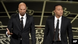 Common, left, and John Legend perform at the 87th Annual Academy Awards, Los Angeles, Feb. 22, 2015.