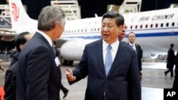 Chinese President Xi Jinping, right, and president and CEO of Boeing Commercial Airplanes, Ray Conner, tour the Boeing assembly line, Wednesday, Sept. 23, 2015 in Everett, Wash. Boeing has agreed to buy 300 jets from Boeing. In addition, state-owned Commercial Aircraft Corp. of China signed a cooperation agreement with the aerospace giant to build a 737 aircraft assembly center in China. (Jason Redmond/Pool Photo via AP)