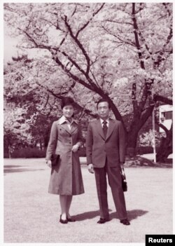 FILE - In this undated handout photo received Dec. 19, 2012, Park Geun-hye poses with her father and then-President Park Chung-hee.