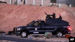 Jordanian security forces leave Swaqa prison, after the executions of Sajida al-Rishawi and Ziad al-Karbouly, two Iraqis linked to al-Qaida, south of the Jordan's capital, Amman, Feb. 4, 2015. (AP Photo/Raad Adayleh)