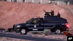 Jordanian security forces leave Swaqa prison, after the executions of Sajida al-Rishawi and Ziad al-Karbouly, two Iraqis linked to al-Qaida, about 50 miles (80 kilometers) south of the Jordan's capital, Amman, Feb. 4, 2015.
