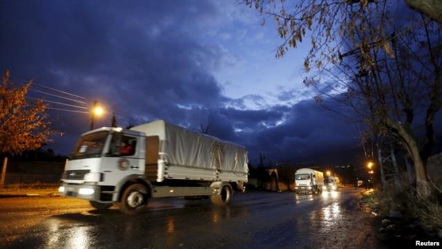 Red Crescent aid convoy enters Madaya, Syria, Jan. 14, 2016.