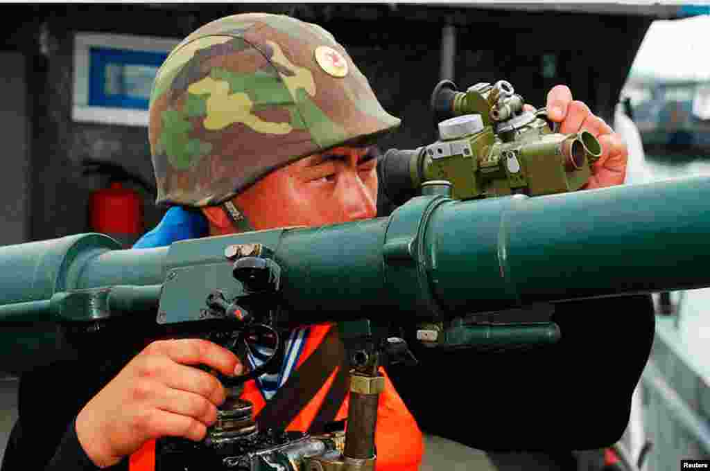 A North Korean soldier attends military training in an undisclosed location in this picture released by the North's official KCNA news agency, March 19, 2013.