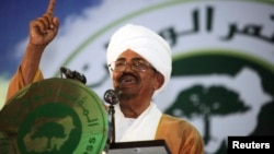 Sudanese President Omar Hassan al-Bashir addresses the general conference of the ruling National Congress Party in Khartoum, Oct. 23, 2014.