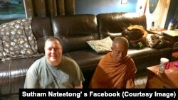 Christian Kobel (L) meditate with the Buddhist monk Sutham Nateetong (R) during the monk visits in his house in Dwight, Illinois. May 31, 2019. The Thai monk is on his journey walk across America to promote peace.