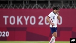 United States' Carli Lloyd leaves the field after being defeated 1-0 by Canada during a women's semifinal soccer match at the 2020 Summer Olympics, Aug. 2, 2021, in Kashima, Japan.