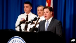 Carver County Attorney Mark Metz, right, announced April 19, 2018 in Chaska, Minnesota, that no criminal charges will be filed in the death of musician Prince in 2016.