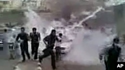 In this image grab obtained by AFPTV from YouTube on March 23, 2011, Syrian protesters run for cover from tear gas during a recent but undated demonstration in the southern town of Daraa. AFP could verify that the pictures were shot in Daraa.