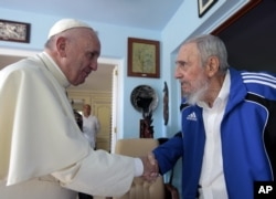 Pope Francis and Cuba's Fidel Castro shakes hands, in Havana, Cuba, Sunday, Sept. 20, 2015.