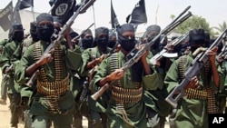 An August 2011 photo shows Al-Shabab fighters marching with their guns during military exercises on the outskirts of Mogadishu.