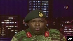 FILE: In this image made from video, Major Gen. S.B. Moyo, Spokesperson for the Zimbabwe Defense Forces addresses to the nation in Harare, Zimbabwe, Nov. 15, 2017.