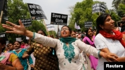 Supporters of India's main opposition Bharatiya Janata Party (BJP) shout slogans as they march towards the residence of the chief of India's ruling Congress party Sonia Gandhi during a protest rally in New Delhi Apr. 21, 2013.