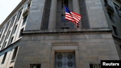 美国司法部大楼。自今年9月以来,司法部已经提起三起涉及中国江苏国安厅情报人员的企业间谍案件。