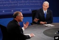 Republican vice-presidential nominee Gov. Mike Pence, right, speaks as Democratic vice-presidential nominee Sen. Tim Kaine listens during the vice-presidential debate.