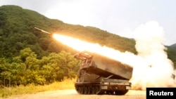 FILE - A rocket is launched from an MLRS during a training exercise involving part of the U.S. 2nd Infantry Division and the South Korean army at Cheorwon, South Korea, June 2012.