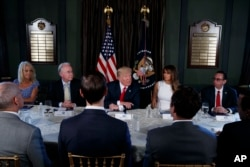 President Donald Trump speaks during a briefing with members of his administration, Aug. 8, 2017, during a working vacation at Trump National Golf Club in Bedminster, New Jersey.