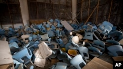 This Feb. 2, 2017, photo shows seats jumbled in a pile inside Maracana stadium in Rio de Janeiro, Brazil. The historic stadium was the site of the opening and closing ceremony.