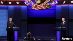 美国总统特朗普和民主党总统候选人拜登参加了在美国俄亥俄州克利夫兰凯斯西储大学举行的2020年首次总统竞选辩论。(2020年9月29日)