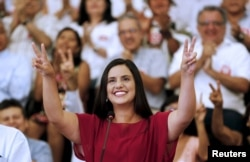FILE - Peruvian presidential candidate Veronika Mendoza of the Frente Amplio party gestures during an event to introduce her team in Lima, March 28, 2016.