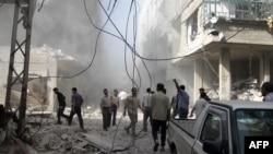 A handout picture released by the Syrian opposition-run Shaam News Network shows Syrians inspecting the damage following an air strike in Arbeen in the suburbs of Damascus on July 6, 2013.
