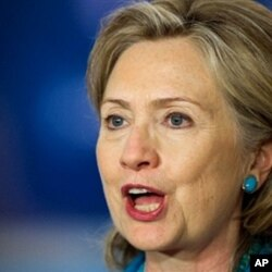 La secrétaire d'Etat Hillary Clinton répondant aux questions des journalistes sur Amiri à washington