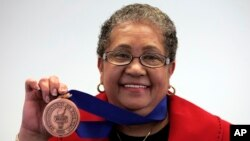 Beverly Hall, former Atlanta superintendent of public schools, holds up her award after she was named the 2009 Superintendent of the Year at the American Association of School Administrators' National Conference on Education in San Francisco, (File photo)