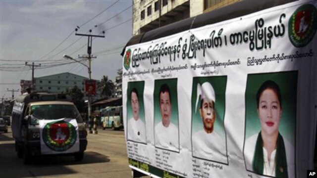 Members of the Union Solidarity and Development Party drive a campaign vehicle with posters of the party's candidates who ran in the November 7, 2010 general elections (FILE)