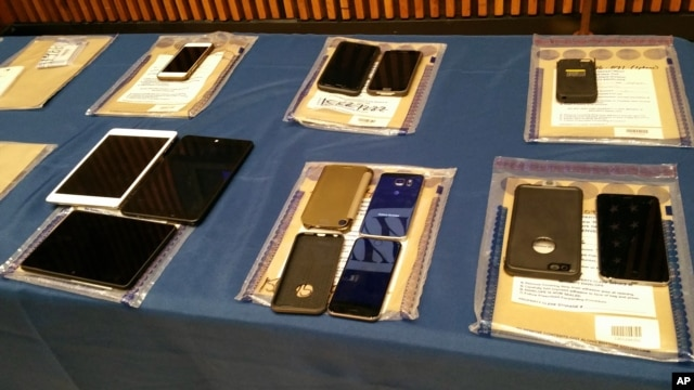Apple iPhones and iPads are seen during a news conference at New York City Police Headquarters, Feb. 18, 2016. New York City Police and prosecutors  said Apple's encryption technology routinely hinders criminal investigations.