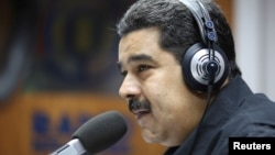 Venezuela's President Nicolas Maduro speaks during his radio program at Miraflores Palace in Caracas, Venezuela, Dec. 26, 2016.