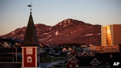 FILE - The sun sets over Nuuk, Greenland, July. 31, 2017.