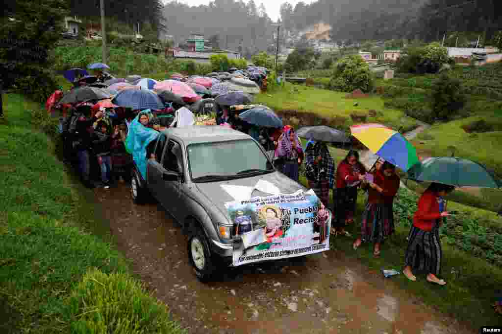 Relatives and friends of Claudia Gomez, a 19-year old Guatemalan immigrant who was shot by a U.S. Border Patrol officer, take part in her funeral procession towards a cemetery in San Juan Ostuncalco, Guatemala, June 2, 2018.
