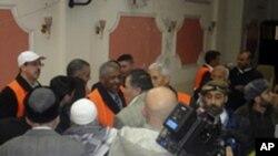Arab League observers (orange vests) talk to people during a visit to Zabadani, near Damasus, Syria, January 21, 2012.