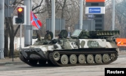 FILE - Pro-Russian rebels drive a Strela-10 self-propelled anti-aircraft system in Donetsk, Feb. 3, 2015.