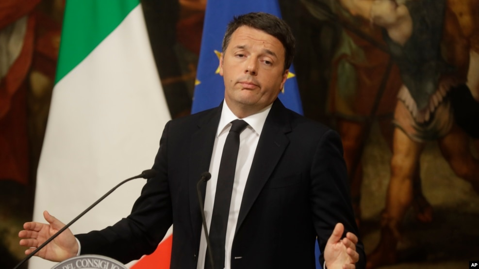 Italian Prime Minister Matteo Renzi speaks during a press conference at the premier's office Chigi Palace in Rome, early Monday, Dec. 5, 2016. Renzi acknowledged defeat in a constitutional referendum and announced he would resign on Monday.