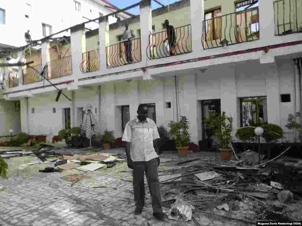South Sudan Hotel manager Mel Garang Yout surveys damage after fire ripped through the hotel on Oct. 2, 2013.